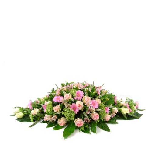Ovaal rouwstuk met roze rozen en gerbera's