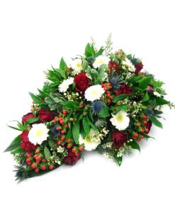 Druppelvormig bloemstuk in de kleuren rood-wit-blauw. - Duoplant