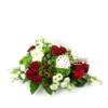 Persoonlijk rouwstuk met rode rozen en speelkaarten